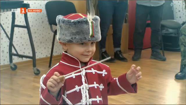 Малкият диригент на Гвардейския представителен духов оркестър